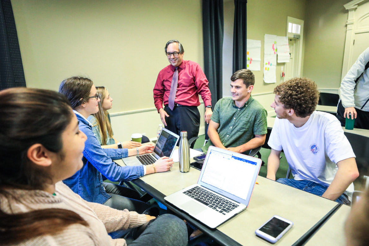 Dr. Victor Hinojosa and students in the social innovation lab