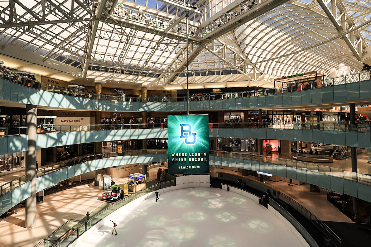 Above the ice rink in the Dallas Galleria #BaylorLights messaging invites passersby to learn more about Baylor.