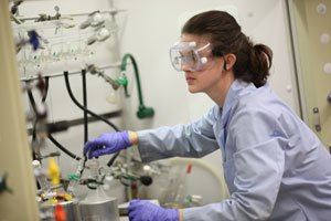 Image of a female student in a chemistry lab