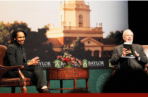 Photo of Condoleezza Rice talking with Ken Starr on stage