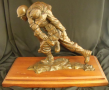 Bronze, one soldier carrying another on his shoulders, mounted on removable wooden base