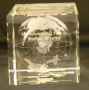 Glass cube, globe world etched inside,