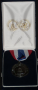 Congressional Award Medal with ribbon in blue case