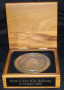 Wooden box with bronze medallion,