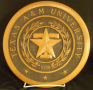 TAMU Seal etched in wood circle