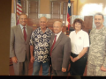 Photo of Chet Edwards with 4 others in office, Army Corp of Engineers