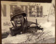 Photo of soldier firing machine gun, signed,