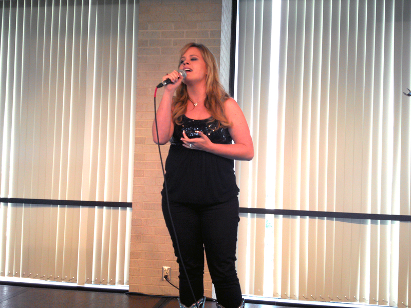 As a special treat to those in attendance, Holly Tucker sang a few songs.