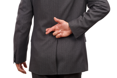 Stock photo of a businessman with his fingers crossed behind his back