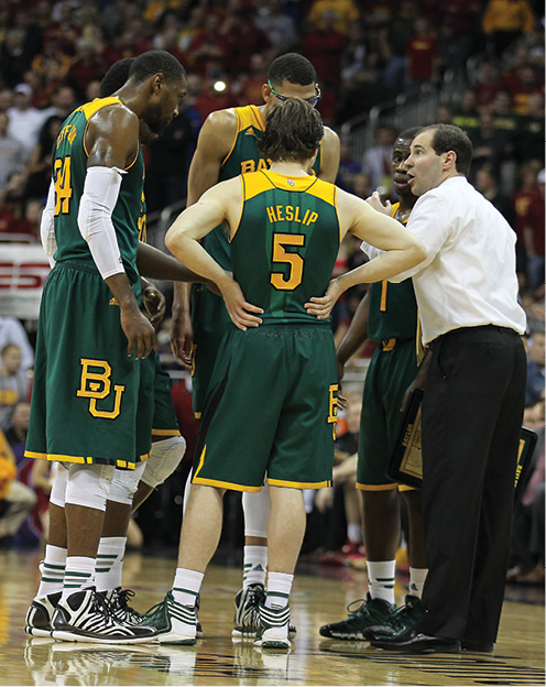 Photo of Baylor Men's Basketball in a huddle during a game