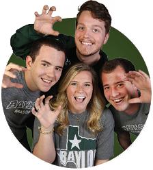 Group photo of four students doing a Sic Em