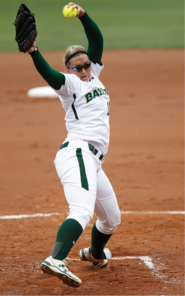 Photo of a Whitney Canion pitching in a softball game