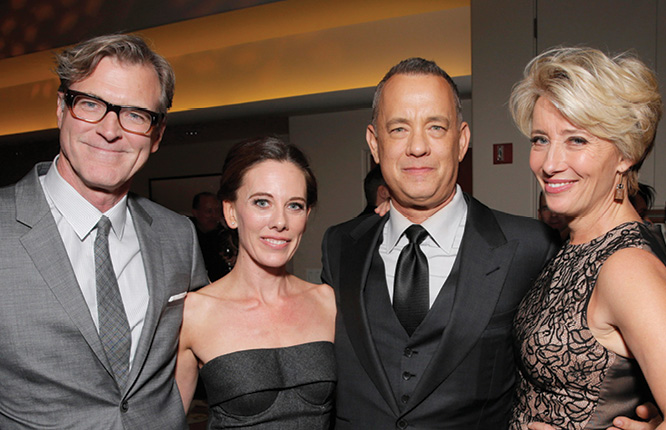 Photo of John Lee Hancock with Tom Hanks and Emma Thompson, as well as Kelly Marcel