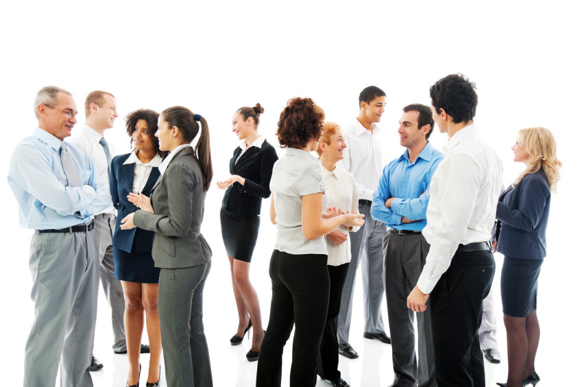 Stock photo of businessmen and women standing in a white studio
