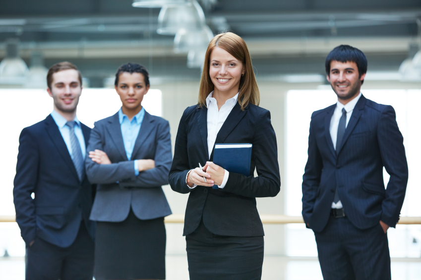 Stock photo of business men and women posing for a group photo