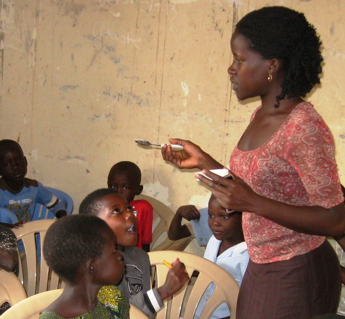 Julian conducting a health sensitization for kids at a CI project