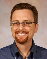 Associate Professor, John Carlson