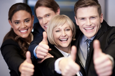 stock photo of business people giving a thumbs up