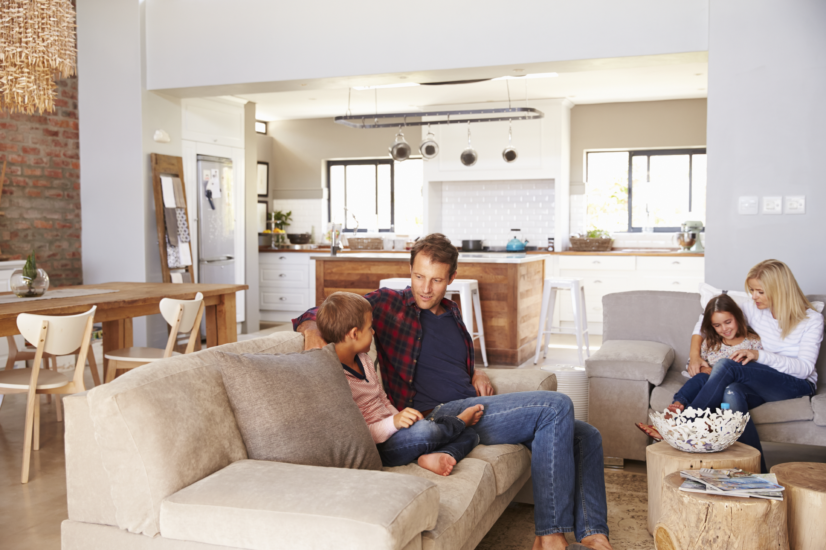 Stock photo of a family sitting in their living room