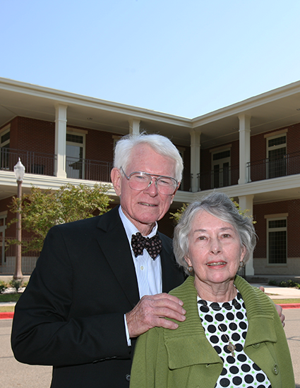 Photo of the McMullens in front of their namesake building