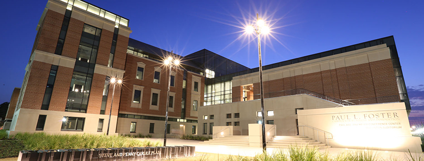 Paul L. Foster Campus for Business and Innovation building at night