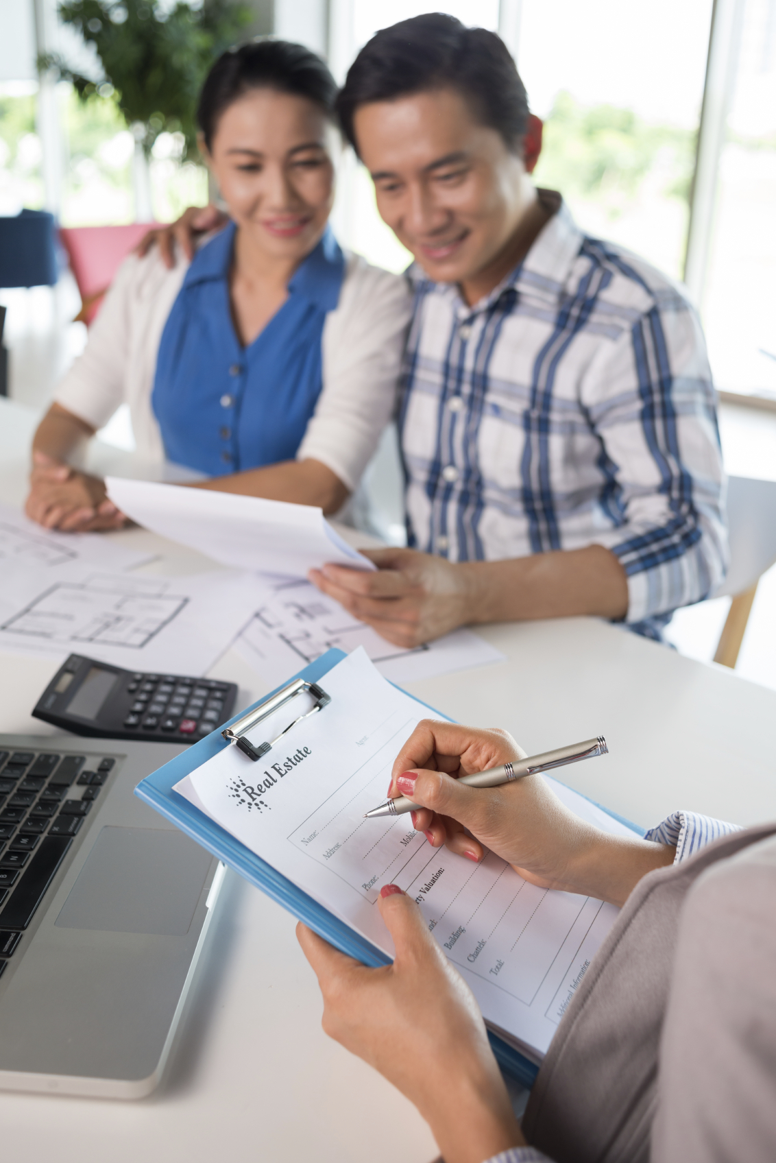 Stock photo of couple meeting with real estate agent