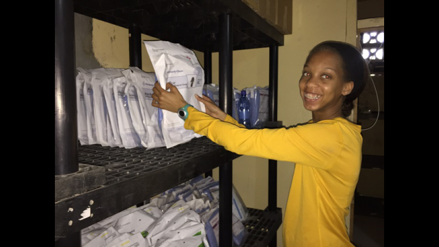 Moriah Dadson works in hospital inventory storage room