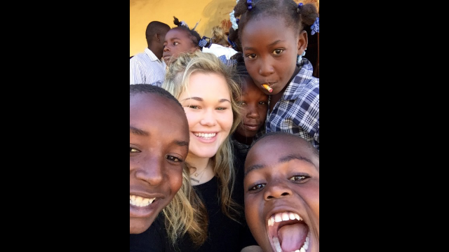 Ashley Bauchmann plays with kids at Promise for Haiti school