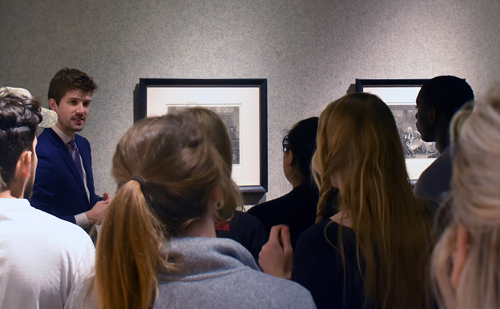 Dr. Sean DeLouche discussing original Hogarth print series with students