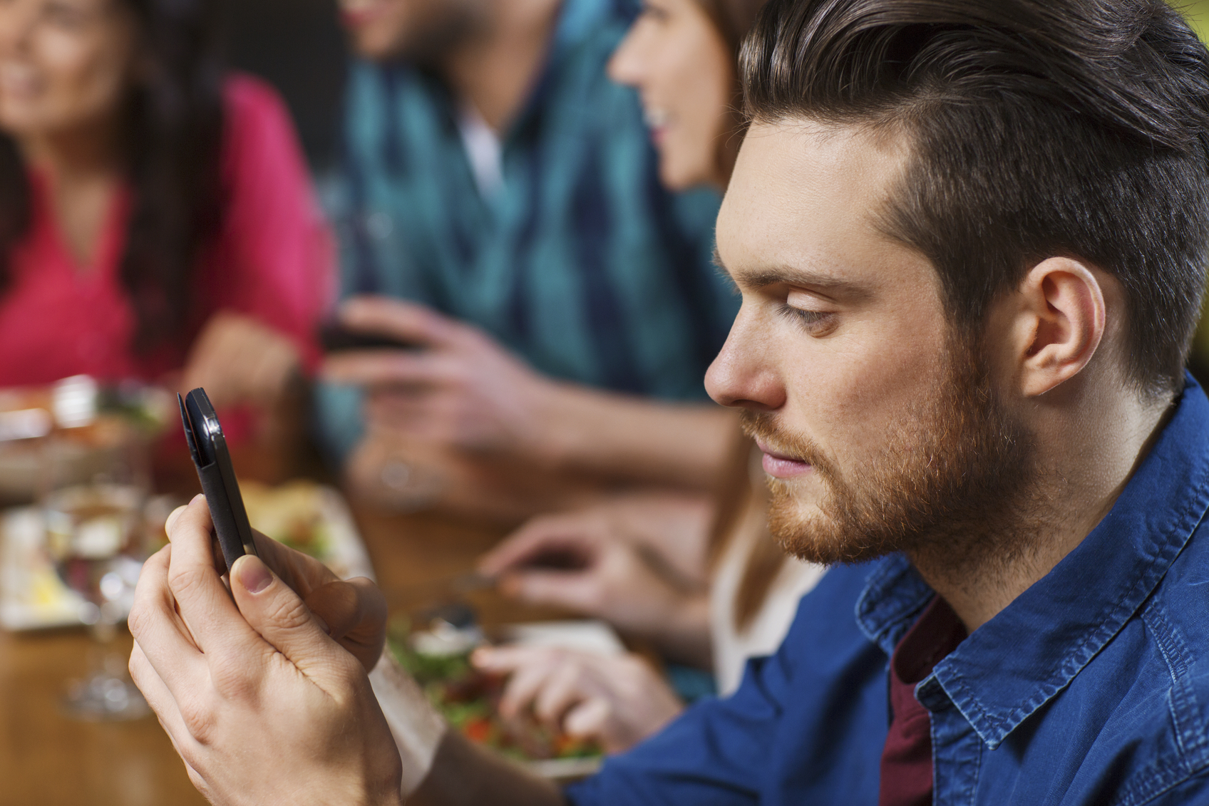 Stock photo of a man looking at his phone