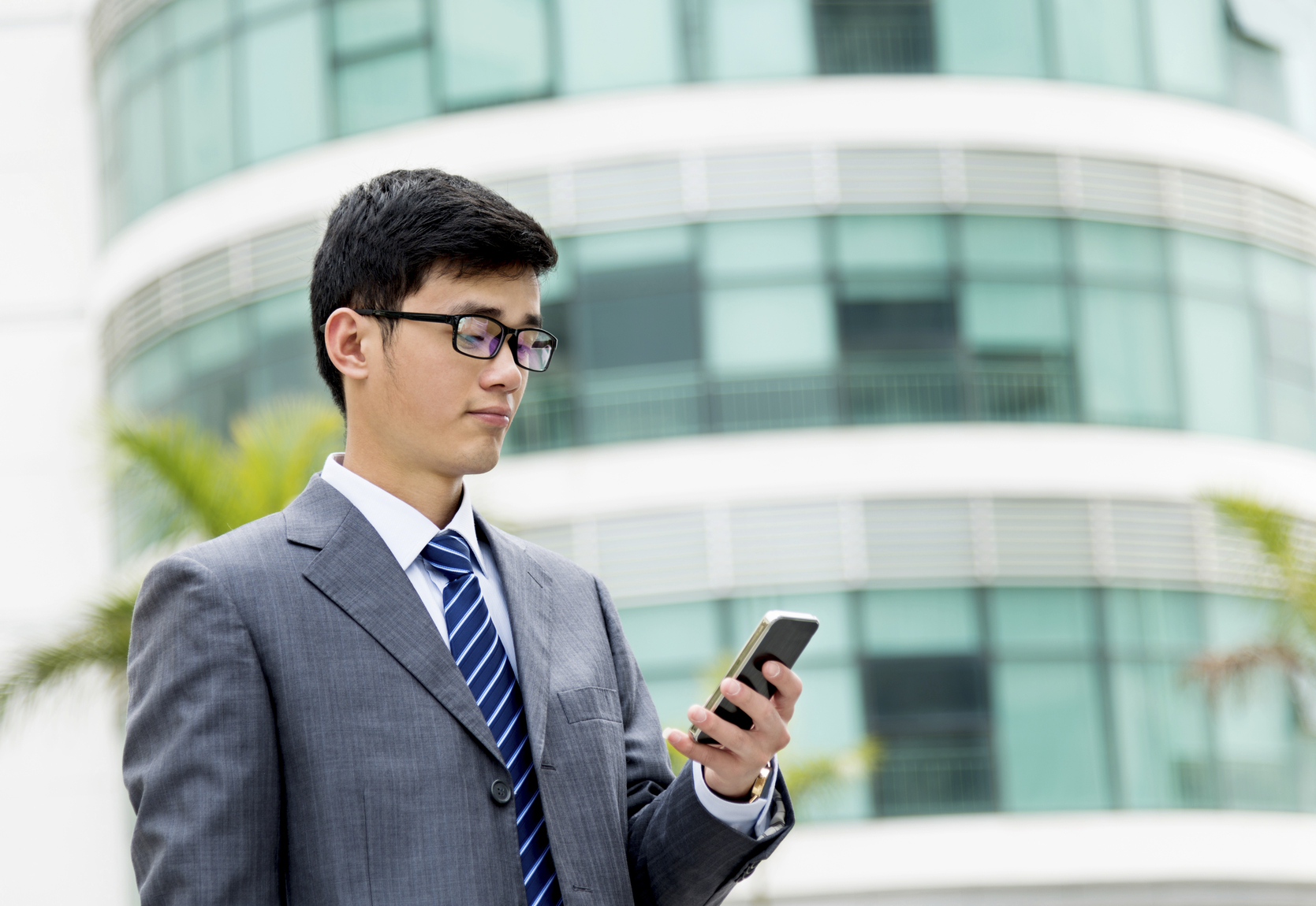 Stock photo of a businessman looking at his phone