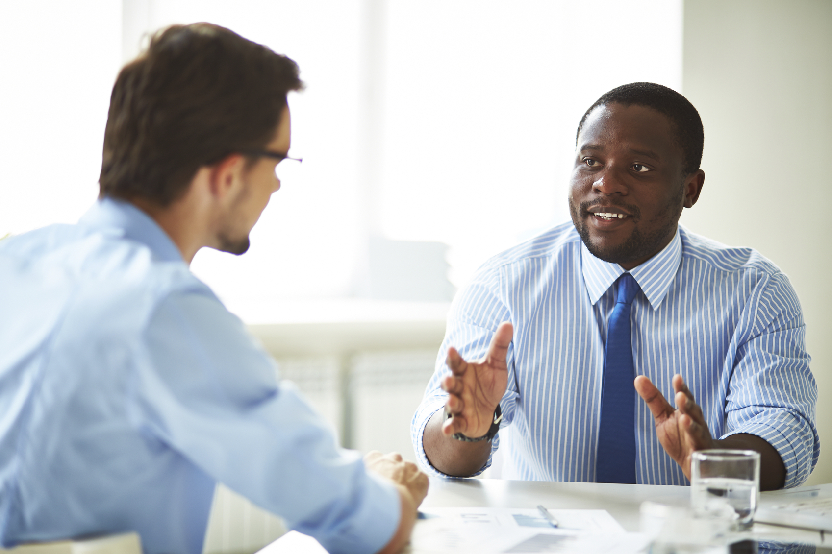 Stock photo of two businessmen having a discussion