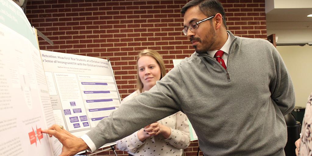 Dr. Rishi Sriram looks at a graduate research project