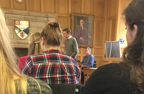 Students in a storied classroom in St. Andrews listen to Dean Toben speak