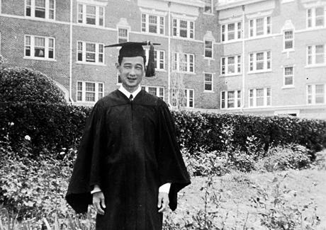 Takashi Kitaoka pictured in graduation robes