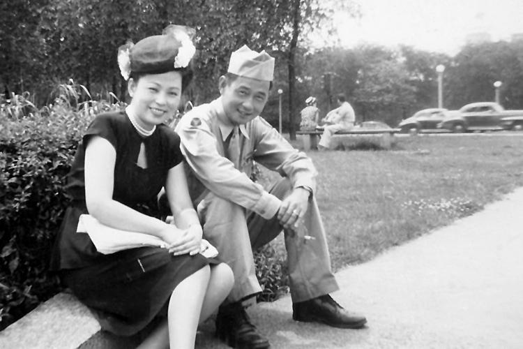 Takashi Kitaoka and his wife, Yuki, sitting on a bench in Wisconsin