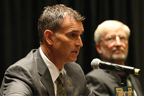 Athletic Director, Mack Rhodes, addresses a press conference