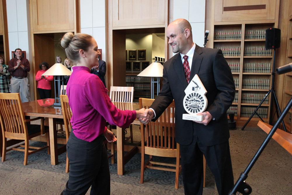 Cassie Hansen accepts her award