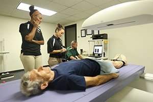 students study the body scan of a patient