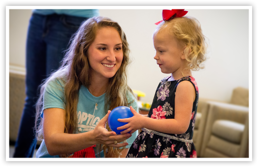 A student helps a child during Baylor Law Adoption Day