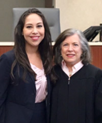 Ariane Flores poses with Judge Patterson in a photo