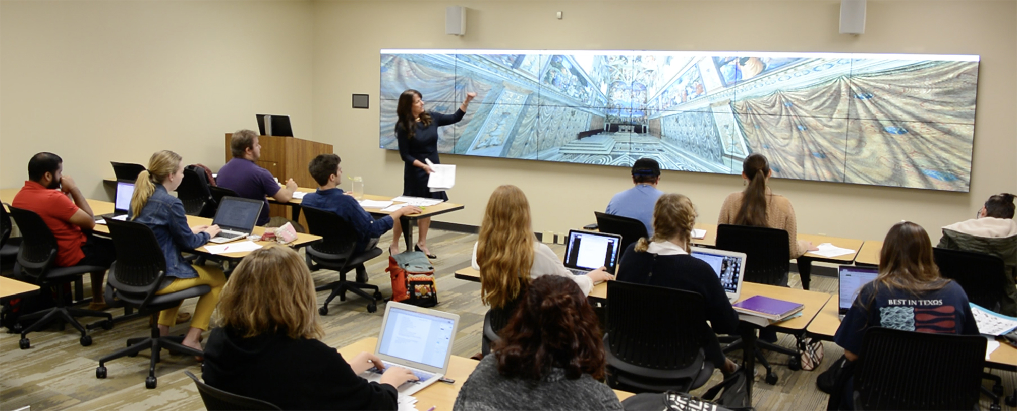 Dr. Heidi Hornik and Art History students in the 20 foot screen visualization lab.