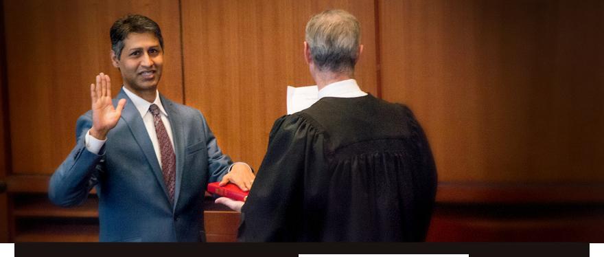 Photo of Vik Deivanayagam being sworn in