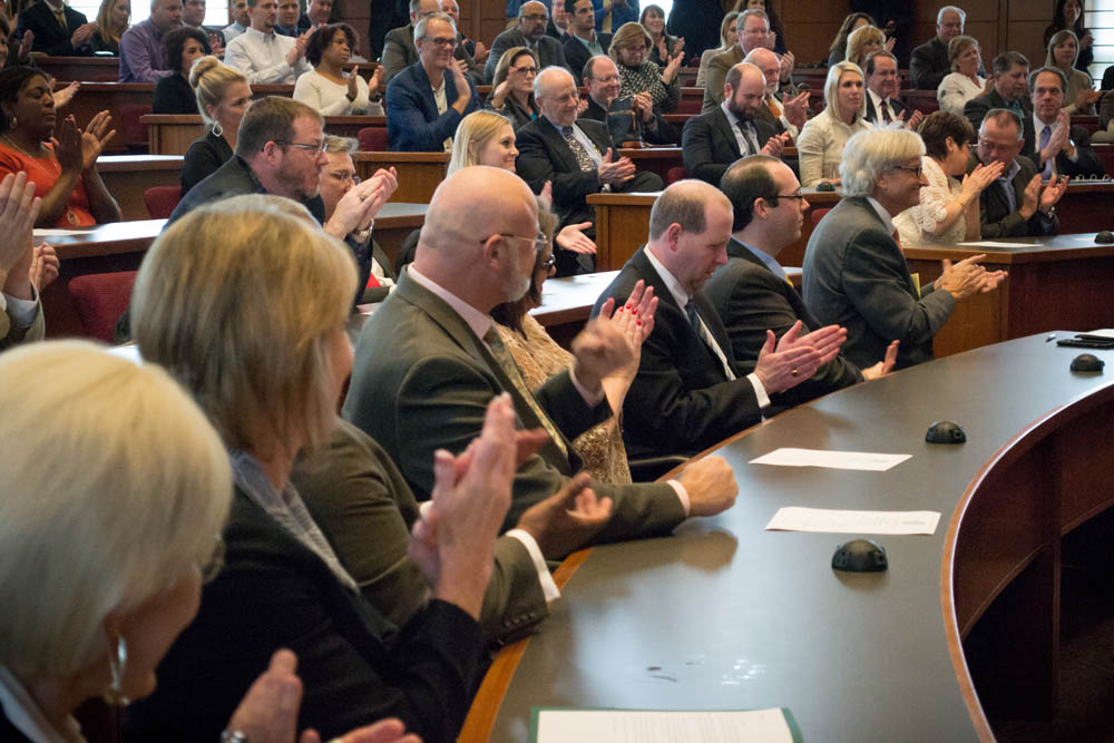 A full classroom applauds at Baylor Law