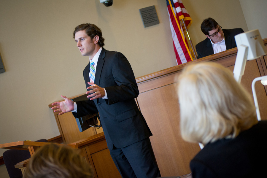 A counselor speaks to the court, dressed in full business suit