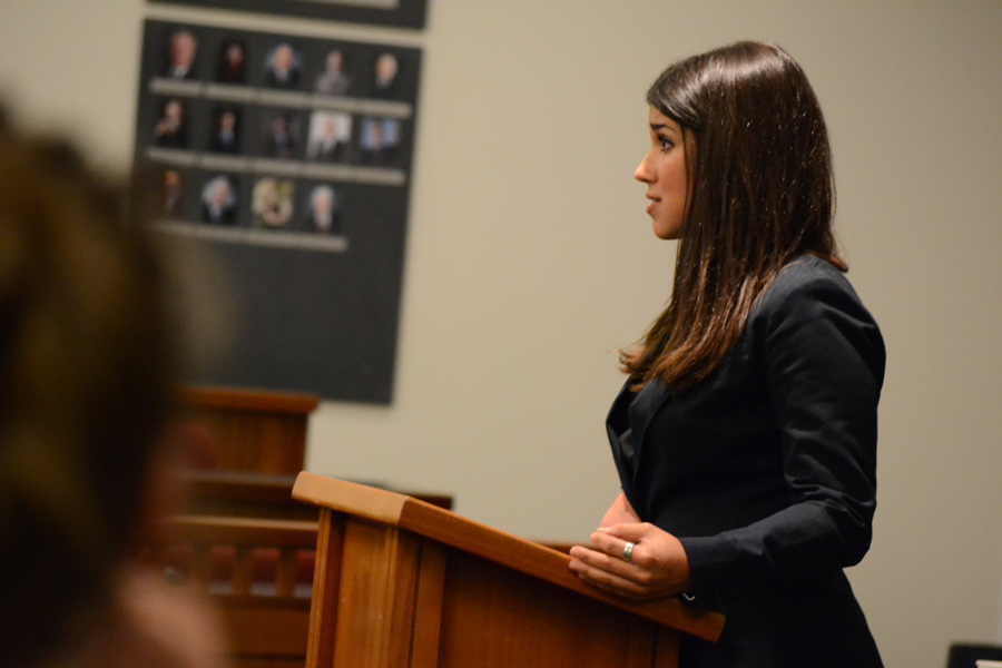 Profile of a female law student speaking to the judge and court