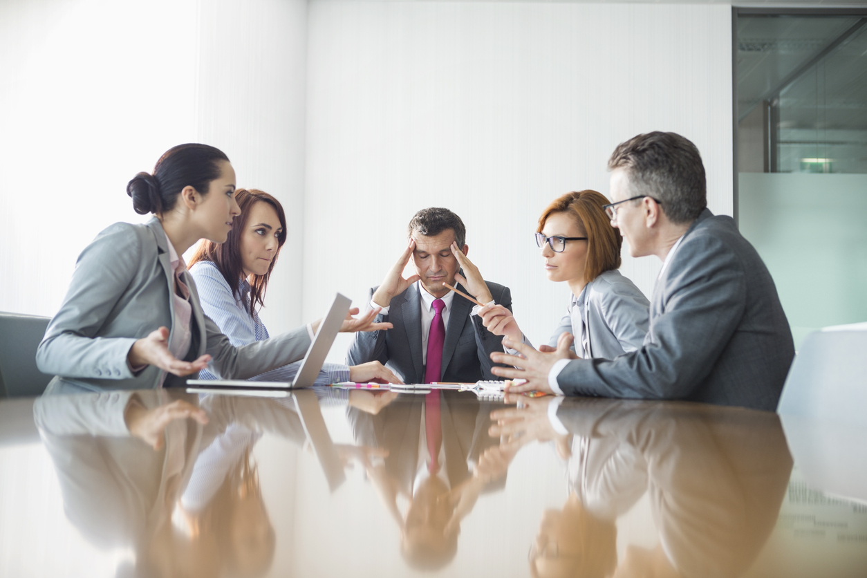 Stock photo of business meeting with the leader showing angst