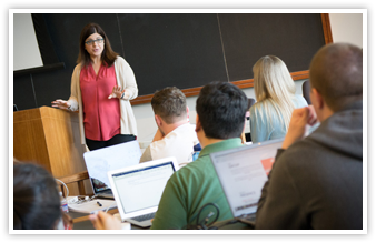 A professor teaches from the blackboard at Business Law Boot Camp