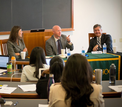 Professors seated at the front of the Baylor Law Classroom discuss Business Law to a full classroom