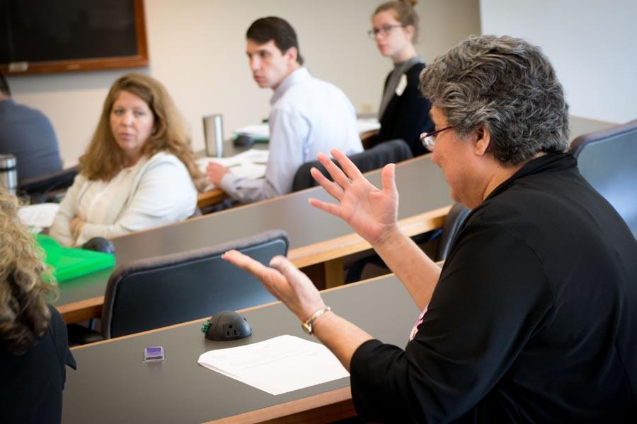 A professor explains concepts to a rapt audience